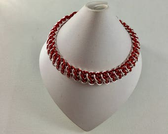 Chainmaille weave. Great southern gathering weave bracelet made with red and silver plated rings and finished with a lobster clasp.