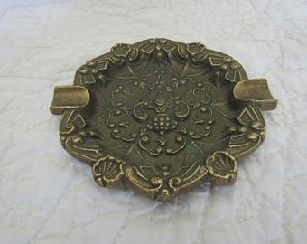 Vintage brass ashtray, sexy girls showing there pussy