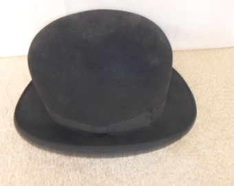 Mans black derby hat