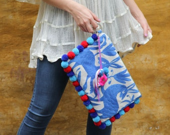 Periwinkle blue wth Red and blue pompoms and hand embroidered tassels