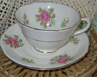 PAIR of COLLINGWOOD CHINA, cups and saucers, white with pink roses, gilt trim, mailed from Canada