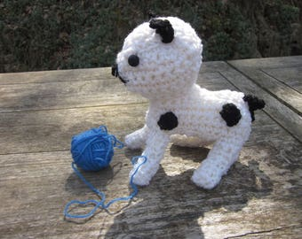 White crocheted, speckled with black kitten