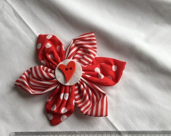 Red and white spots and stripes cotton flower brooch with red heart button detail