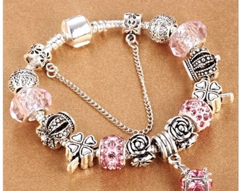 Pink charm bracelet with decrecative crystal ball charm