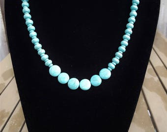 Turquoise necklace with flat and round beads