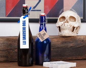 You Deserve It! Set of 3 Letterpress Wine Bottle Gift Tag. Blue ink with blind impression and blue ribbon. Letterpress gift bottle tag