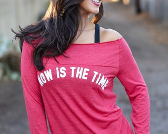 Now Is The Time. Off the Shoulder Long Sleeved Long Heathered Tee, Sport Striped Wrists. Made in the USA. Customizable Long Sleeve Shirt.