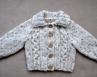 Babies/toddlers hand knitted, cable front jacket / sweater in specked yarn.