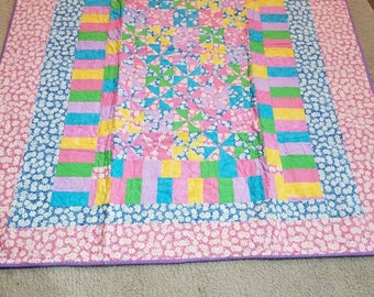 Small pinwheels throw quilt