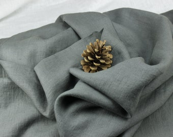 Grey color 100 % washed Linen fabric (200 g/m2). Densely woven, softened, washed linen grey color fabric