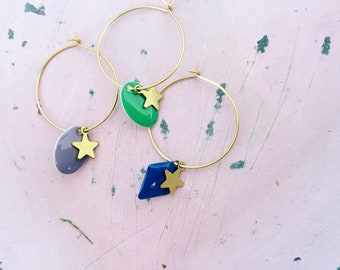Hoop earrings with enamel pendants and brass stars
