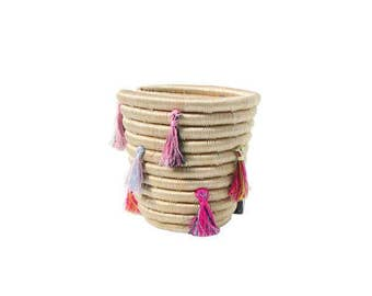 Mini basket decorated with multicolored tassels