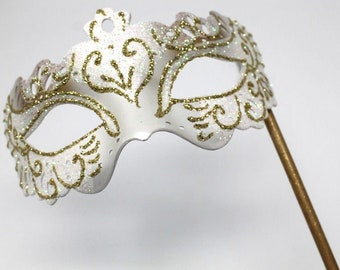 White and Gold Butterfly Mask on a Gold Stick