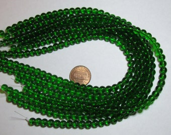 One Strand of 6mm Round Glass Beads- Emerald Green- about 50 beads on a strand