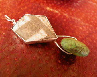 anasazi pottery shard and turquoise pendant set in sterling silver