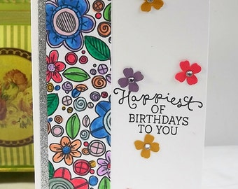 Birthday card, hand coloured with silver glitter embellishment, and die cut flowers
