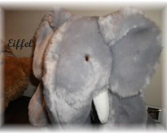 Eiffel  Elephant is a 13 inches  Handdewn   One-of a  Kind  with sound box
