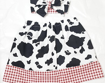Country western cowgirl skirt with headwrap. Cow print skirt with cow print headwrap. cowprint and plaid skirt and bow yeehaw!