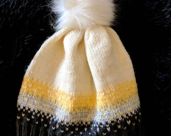 Patterned knit hat with removable pom pom