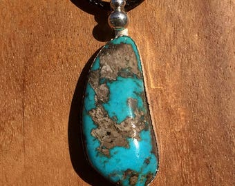 Turquoise Cabochon Pendant set in Fine Silver.