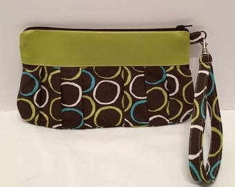 AK30- Compleat Clutch: in a fwonderful green and teal circle print with pleated front, zipper closure and detatchable hand strap