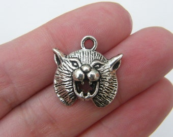 6 Wildcat charms antique silver tone A153