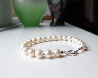 Freshwater pearl bracelet - hand knotted silk - sterling silver