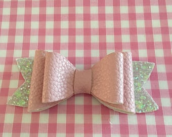 Soft pink leather bow with glitter background with clip