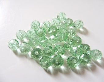 "20 faceted glass beads 8 x 6 mm ""light green"""