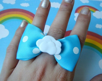 Blue bow tie with white polka dot and cloud ring