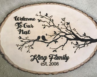Wood burned plaque with branch