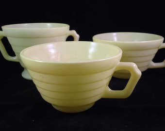 vintage light yellow coffee cups and sugar bowl