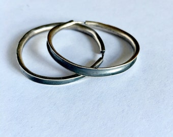 "Sterling silver anticlastic hoops. 2"" diameter"