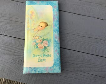 Beautiful vintage baby's photo album / diary book