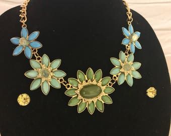Floral statement necklace with earrings. Blue and green floral stone statement with matching greenish yellow stone earrings