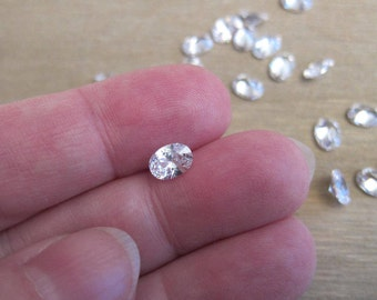 7x5mm Cubic Zirconia Gemstones, White, Grade AAA, Pointed Back, Faceted Oval - Wholesale - Available in 4 & 6 Stone Pkgs and in Larger Pkgs
