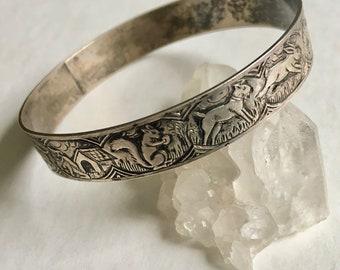 fantastical old animal bangle in sterling