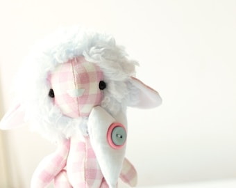 Stuffed toy sheep with a fur head and a big white heart. Miniature baby toy. Toy lamb animal fabric sewn 100% handmade