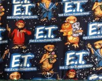 "E.T. on black fabric, By the Half Yard, 44"" wide, 100% cotton"