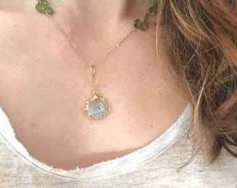 Stalactite pendent on goldfilled necklace with faceted green garnet briolettes.