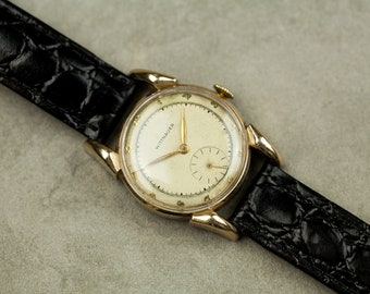 Vintage Wittnauer Wind Up mechanical watch with 10k gold plated case and new black leather strap