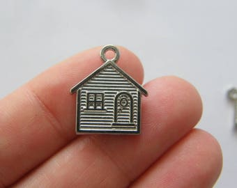 4 House charms silver tone P441