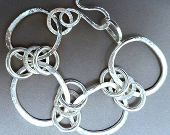 Sterling silver hand forged triple link secure bracelet. Substantial! Forged and formed from heavy sterling with handmade hook and closure.