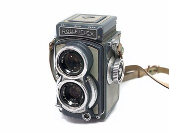 Rolleiflex Baby 4x4 TLR film camera with hard case, working