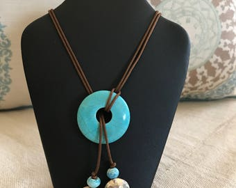 Lariat Necklace with a turquoise donut stone with hammered sterling silver beads