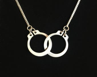 LOCK 'EM UP! Necklace - Tiny hand cuffs locked together