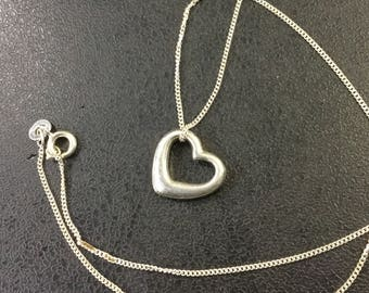 Silver heart pendant on chain