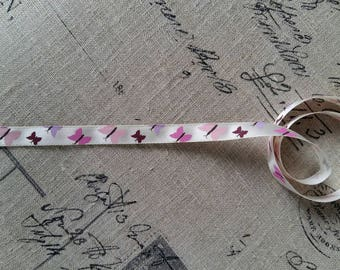 1 meter of butterfly patterned beige satin ribbon