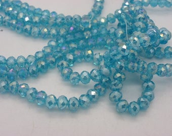 100 4-5 mm glass Crystal beads has transparent turquoise blue faceted