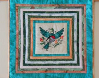 teal hummingbird in flight